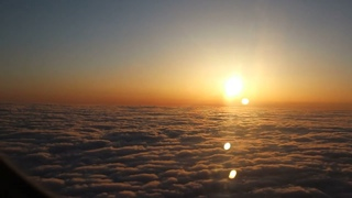 View of a beautiful sunset above the clouds from my window seat.