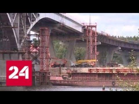 Глава Московской области дал старт стыковке пролетных сооружений моста через Волгу в Дубне Росси…