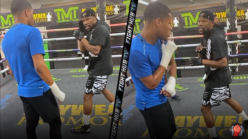 FLOYD MAYWEATHER TEACHING DEVIN HANEY SHOULDER ROLL DEFENSE HOW TO THROW POWER JABS