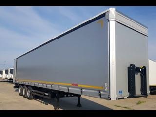 KÖGEL CARGO NOVUM SNCO S24-1 - полуприцеп для дальних перевозок полным весом 39 тонн, с планшетной платформой, съёмными бортами