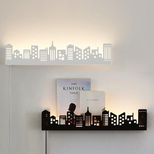 Полочки с подсветкой повторяющими контуры мегаполиса